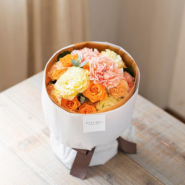 花キューピットのサブブランド、プシュケのフラワーブーケ。テーマはウォーム。オレンジクリームイエロー。