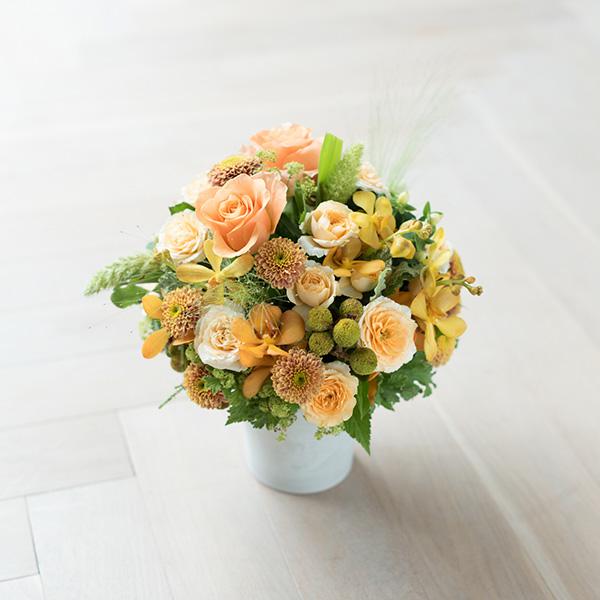 花キューピットのサブブランド、プシュケのフラワーアレンジメント。テーマはウォーム。オレンジブラウングリーン。