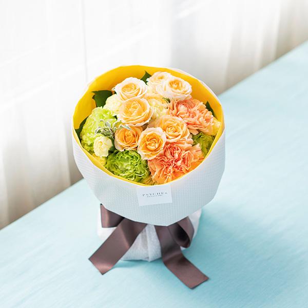 花キューピットのサブブランド、プシュケの生花ブーケ。テーマはサニー。オレンジグリーンアプリコットの花束。